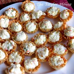 Crab and Cream Cheese Bites 5 oz. Cream Cheese, softened 2 tbs Mayo 2 sticks imitation crab meat, diced (about 1/4 cup) 3 stalks green onion, diced Garlic Powder to taste 1 box Filo cup shells duck sauce for dipping Combine cream cheese, mayonnaise, green onion and garlic powder. Fold in shredded crab meat until well combined. Fill each Filo cup with mixture and place on a baking sheet. Bake at 400 degrees for 13 to 15 minutes.