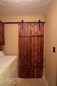epbot make your own sliding barn door for cheap great for laundry room