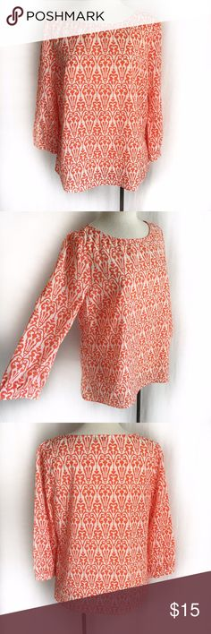 """Dainty Hooligan Chandelier Print Top Coral and cream lightweight patterned blouse. Three-quarter sleeves. Looks great worn loose or tucked in! 100% polyester. Hand wash. Size Medium (size tag is missing). Bust: 19"""" flat across. Waist: 19"""" flat across. Length: 23.5"""" Shoulder width: 14.5"""". *Size tag is missing. EUC. Thanks for looking. Dainty Hooligan Tops Blouses"""