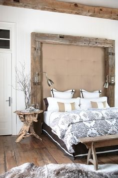 Rustic Wood Bedroom Reclaimed beams along the headboard, rustic floorboards and a driftwood bedside table add a natural, raw look. Fresh white walls and pretty patterned bed linens add a feminine touch to the industrial reading lamps and unfinished wood beams.