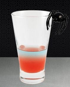 Spider Venom  1 oz Tarantula 100 Plata tequila 0.5 oz Raspberry puree 0.5 oz Fresh lime juice Shake above ingredients with ice and serve in shot glass 1 oz Tarantula Azul Layer the Tarantula Azul tequila on top and shot