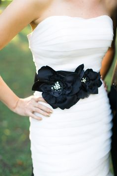Add a black sash to your wedding gown for the party | See the New Year's Eve inspiration shoot on SMP: http://www.stylemepretty.com/2013/12/30/new-years-eve-wedding-shoot/ Elisabeth Carol Photography