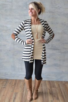 Love the striped sweater, tight black leggings and brown boots.