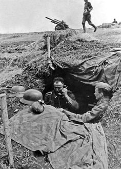 Two radio operators can be seen inside a shelter on the steppe. The soldiers appear to have been here for some reasonable time as two Zeltbahn capes have been used as a tent. There were a number of standard designs for constructing Zeltbahn tents and some of them could house four, eight and even sixteen men. These Zeltbahn tents were ideal rainproof shelters ar were used extensively throughout the war, but they were not designed for front line use.