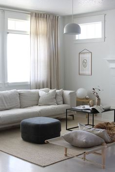 Minimal Scandinavia living room styling by A Merry Mishap | IKEA Nockeby sofa with a Bemz cover in Natural Brera Lino from Designers Guild | linen sofa | velvet pouf | chic nordic decor