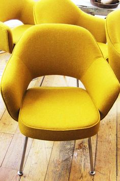 Four vintage Eero Saarinen executive chairs by Knoll, beautifully reupholstered by Amsterdam's Jessica Padt in a luscious mustard wool from Bute.