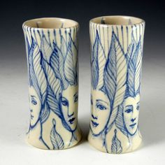 Blue and white faces bud vase by PSPorcelain