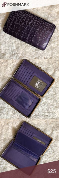 """1️⃣2️⃣HANANEL WALLET HANANEL WALLET  Perfect wallet for the gal on the go!  Colorful, compact and convenient. Sturdy metal frame with easy-open clasp. Multi-function interior accommodates ID photo window, credit card slots, cash, checkbook holder!    ⚜️Measurements are 7.5"""" length x 1"""" width x 4.5"""" height ⚜️Sleek, unique & chic wallet ⚜️Opens easily & lies flat to allow easy access ⚜️Zippered pouch ⚜️Pocket on the back of wallet ⚜️Bonus checkbook cover included Bags Wallets"""