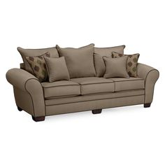 Meeting Place. Gather with friends and family in a graciously inviting space with the Rendezvous III collection. This sofa's casually sophisticated look will liven up your home, with its flared frame, oversize roll arms, loose pillow back and accent welting. The microfiber upholstery is rugged and easily maintained, yet soft to the touch. The neutral tan color will coordinate with nearly any decorating scheme, and a cheerful, graphic accent fabric on the toss pillows tops off the fashiona...