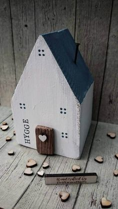 Check out this item in my Etsy shop https://www.etsy.com/uk/listing/502379098/white-wooden-house-hygge-words-recycled