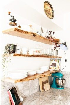 Kitchen makeover featuring floating, live-edge wood shelves