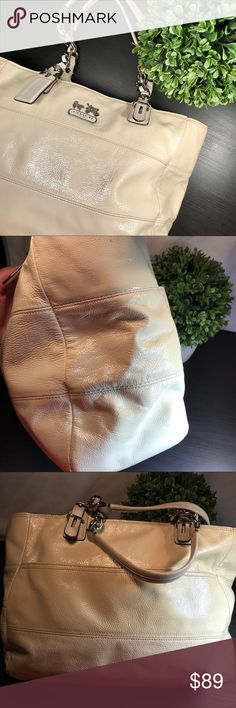 """🌷Coach Cream Tribeca Patent Leather Tote 14123 Authentic Coach. Gently used. Was stored in dust bag. Minimal spots on lining and on outside of bag. Could use a little cleaning. Overall in really in good shape! Approx measurements: 15""""x 9""""x 4.5"""". Horse & Carriage Logo. Big zipper pocket inside w/ 2 functional pockets. Big exterior pocket as well. Beautiful blue lining. 👠 All items come from smoke and pet free home. 10% off bundles of two or more purchases. Reasonable offers accepted! 💜…"""