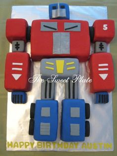 Optimus Prime This cake was for my friend's son. I cut a quarter sheet cake into blocks, fondanted each block then set them together...