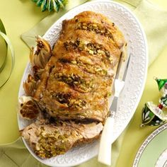 Stuffed pork roast with peppers, celery, onions, and garlic! Seasoned with cayenne, this is sure to be a winner!