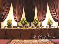Dark color table cloth with matching backdrop drape color.