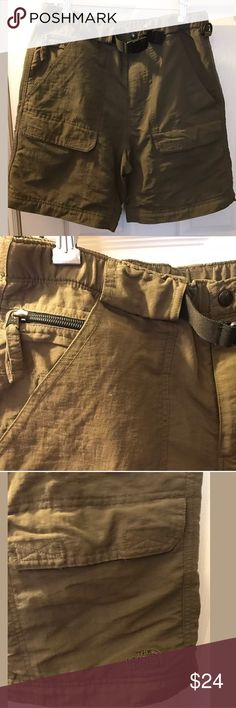 """THE NORTH FACE Olive Green Cargo Shorts Camp Hike These are awesome men's THE NORTH FACE Shorts. It is olive green with several pockets and a belt. These used to be the zip off pants, so there is a zipper at Hem.In excellent condition . I ship every business day!   Size: small Waist flat: 14"""" Inseam: 8""""  Rise: 10.5"""" Hips flat: 20"""" Bin 30 The North Face Shorts Cargo"""