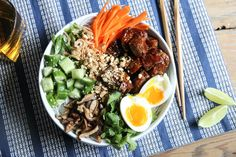 Spicy Gochujang-smothered pieces of filet meet fresh pickles and cool noodles for this easy summertime Korean-inspired noodle bowl.