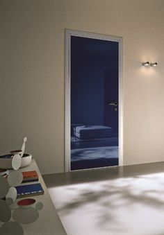 Bauxt's Monolite door with glossy lacquered smooth MDF panel and aluminium trims. Handle H3, polished chrome.