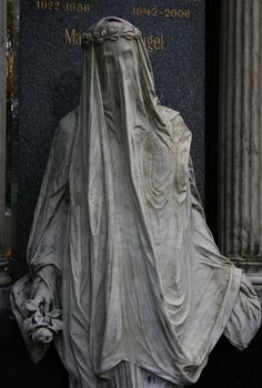 """Statue of a mourner in the Vienna Central Cemetery. This statue is an example of superb stone sculpture, manifestly evident in the fact that one can see the mourner's face """"through"""" her stone veil. Cemetery Angels, Cemetery Statues, Cemetery Headstones, Old Cemeteries, Cemetery Art, Angel Statues, Graveyards, Cemetery Monuments, Greek Statues"""