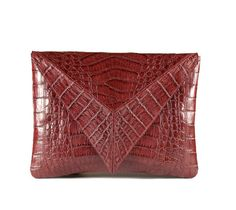 Diamond #crocodile #clutch. Handmade in Colombia. This unique shape ensures instantly stand outs. Perfect for cocktail events. $750