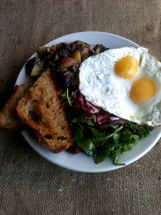 Fried eggs, toast and corned beef hash at Rogue Cafe. Rogue Cafe: Backlash in Berkeley Over Backyard Brunch. Post by Sarah Henry