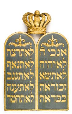 An early twentieth-century carved, painted and giltwood Torah Ark cresting, featuring the crowned Tablets of the Law. (Sotheby's)