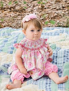Hand smocked girls pink outfit with paisley top dress and pink pants, it is a super gorgeous little outfit perfect choice to wear during Spring and Summer months. Ideal for Birthday parties and to tak