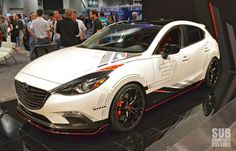 Club Sport Mazda3 Concept from the Mazda Booth: LSD, different gears, and CUSCO coilovers. #SEMA 2013
