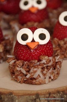 Strawberries stuffed with cream cheese set atop chocolate Rice Krispie Treats make cute, fruity bird nests.