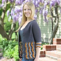 "Alexandrium Cardigan | crochet pattern by Sara Delaney. Bottom up, seamless raglan with vertically worked lace detail. Could be done in a solid color, with just a contrast color border on the front. Sizes up to 52"" bust."
