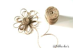 How to make a twine flower in about 10 minutes time.  So cute! I can embellish the world with these.