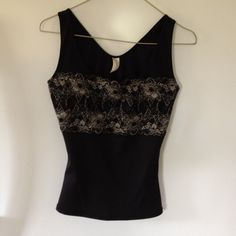 Black tank top Black tank top with lace overlay on front. Stretch nylon fabric. Tighter fitting. FLEXEES Tops Tank Tops