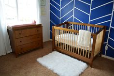 Navy herringbone accent wall in a modern nursery - love! | Project Nursery