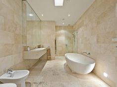 Consider using travertine in a tumbled finish for a warm, soft and rustic look throughout the bathroom. Description from spotlats.org. I searched for this on bing.com/images