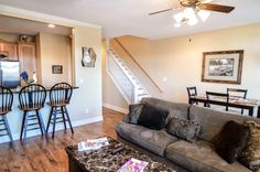 Visible on the image is the stairway up to the second level of the property, the breakfast bar, dining area and part of the beautiful living room!  For more info please contact Rick Andrews 706-970-7120 or email info@bestmountaindeals.com