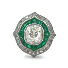 A diamond and emerald ring in the Belle Epoque style.