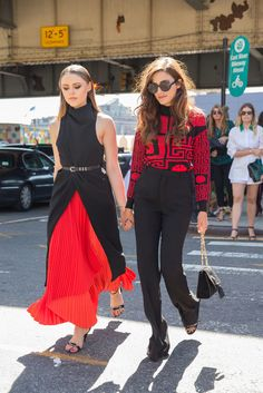 Best friends match their street style looks: different combinations of red and black