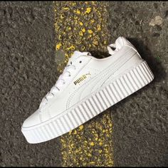 PRE-ORDER Puma Rihanna Creeper (White Glo) This is for a pre order of the Rihanna creeper that is being released May 26th. The shoe is not suede but a leather material in an all white color. It will come in original box with receipt of the store it was bought from. $200/️️. I am a trusted seller. Puma Shoes Sneakers