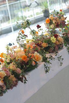 秋の暖かなオレンジと実もののナフキンフラワー ツキ・シュール・ラメール様へ