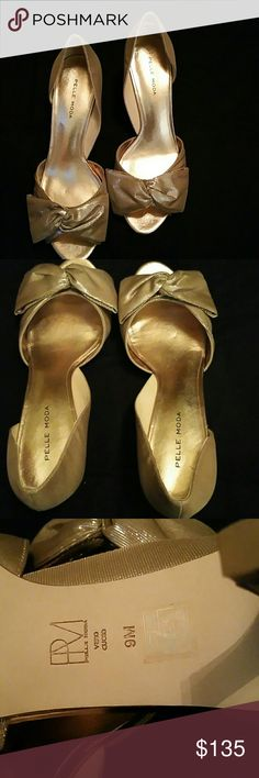 PELLE MODA Alera Champayne d'orsay Peep-T 9 NWOT PELLE MODA  New no tags Never worn NO SHOE BOX  Alera champayne shimmer metallic & moire silk d'orsay peep toes with twisted bow on the vamp Kitten heels Size 9 (39) Made in China Pelle Moda Shoes Heels