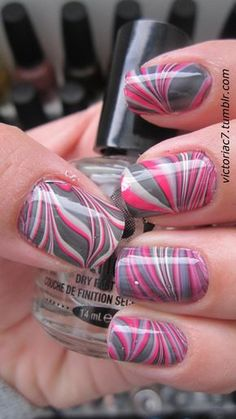 Pink and grey water marble nails. Just pour polish in water, wait until they mix the way you want at the surface and dip your nails in. I would love to get my nails done like this sometime soon. Fancy Nails, Love Nails, Diy Nails, How To Do Nails, Nail Art Designs, Marble Nail Designs, Nails Design, Gorgeous Nails, Pretty Nails