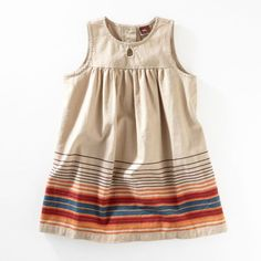 So many markets in Mexico, so many wonderful ways to be inspired. We loved all the ways you can show your stripes, from blankets to shawls. Your little one will show her stripes in bold new ways in her Mercado Stripe Dress.  Hits above the knee. Pairs perfectly with indigo leggings. Imported.