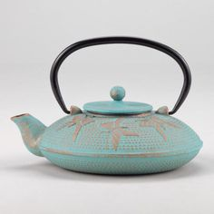 One of my favorite discoveries at WorldMarket.com: Aqua Butterfly Teapot. I want it!!