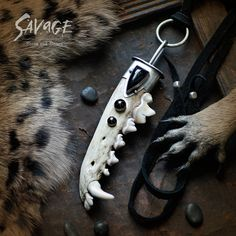"""""""Throw me to the wolves and I will return leading the pack."""" Dire Wolf Pendant... bone and black jade set in sterling silver."""