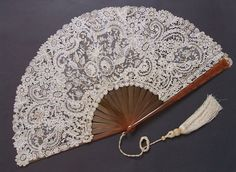A hand fan, any kind wood w/lace or priced wood, or fabric just a sturdy one.  I love using mine on a hot day but it broke : (