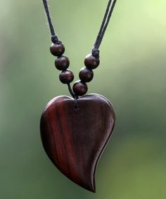 """Simple and pretty enough to wear every day, a masterfully carved heart of natural beauty centers the design of this necklace from Bali. Weight: 0.28 oz Measurements: - Cord length: 15"""" min L - x 32.5"""""""