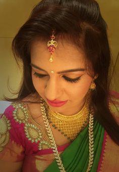 Traditional Southern Indian bride wearing bridal hair, silk saree and jewellery. Muhurat look. Makeup by Swank Studio. #BridalSareeBlouse #SariBlouseDesign   Find us at https://www.facebook.com/SwankStudioBangalore