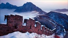 Snow on the Great Wall, Beijing, China (© Panorama Stock)  December 14, 2013   It seems like most photos of China's Great Wall come from summer vacations full of blue sky and peaked green hills. But the wall loosely follows the east-west border of Inner Mongolia in the north, where winters can be long and cold. So it's not unusual for the wall to look like this, capped with a bit of snow.