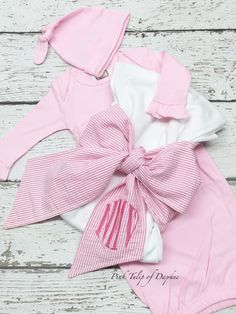 A personal favorite from my Etsy shop https://www.etsy.com/listing/465386965/swaddle-blanket-with-bow-and-gown-set