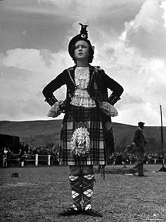 The Winner of 1955 event  being awarded as the best dressed dancer in Highland a Costume.